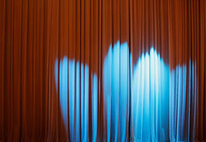 Spotlight. Multiple blue spotlight on a concert hall curtain Royalty Free Stock Photo