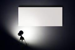 The spotlight. Small spotlight lighting blank white advertisement board on the wall stock image