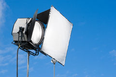 Spotlight. For film and television on blue sky background Royalty Free Stock Photography