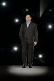 Spotlight. Businessman standing in the spotlight Stock Images