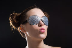 In the spotlight. Pretty brunette with weird sunglasses in the spotlight Stock Photos