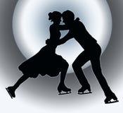 Spotlight Back Silhouette Ice Skater Couple. Spotlight Back Silhouette of Ice Skater Couple in Embrace Stock Image