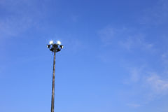 Spotlight with blue sky background Royalty Free Stock Photography