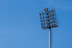 Spotlight with blue sky at stadium Stock Images