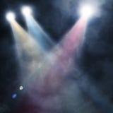 Spotlight  blue on smog background. Background in show. Spotlight on smog Stock Photo