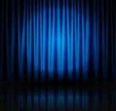 Spotlight on blue stage curtain Stock Photos