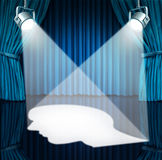 Spotlight On The Brain. With lights shinning a human head shaped profile on a stage with blue velvet curtains as a mental health concept for cognitive disorders royalty free illustration