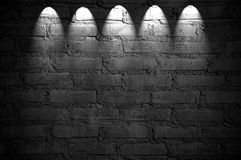 Spotlight on the brick wall Royalty Free Stock Photos
