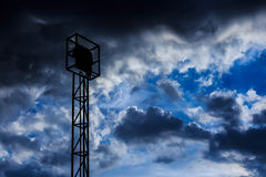 Spotlight and cloudy sky Royalty Free Stock Photo