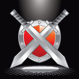 Spotlight on crossed swords and shield Royalty Free Stock Images