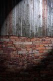 Spotlight on Dark Grungy Wall Royalty Free Stock Photos