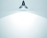 Spotlight. On empty wall stock photography