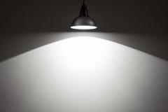 Spotlight. On empty wall, old lamp stock photography