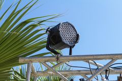 Spotlight on fastening. Blue sky and palm stock photography
