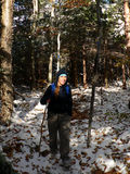 Spotlight Female Hiker. Female hiker hiking through on a snowy trail has the sun breaks through Stock Images