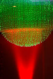 Spotlight Fiberoptics. Red spotlight background with green fiberoptics chandeleir, christmas background or lounge lighting Royalty Free Stock Photo