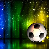 Spotlight football glitters background with soccer ball Stock Photo