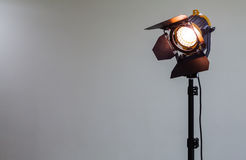 Spotlight with halogen bulb and Fresnel lens. Lighting equipment for Studio photography or videography.  Stock Photos