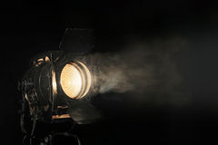 Spotlight in the haze. Spotlight in a smoke on a black background Stock Photography