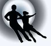 Spotlight Ice Skater Couple Side by Side. Spotlight Back Silhouette of Ice Skater Couple Side by Side Turn Royalty Free Stock Image