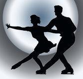 Spotlight Ice Skater Couple Side by Side. Spotlight Back Silhouette of Ice Skater Couple Side by Side Stock Images