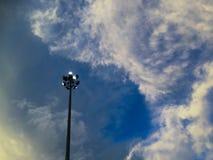 Spotlight on the left of cloudy blue sky Stock Photo