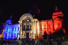 Spotlight Light Festival, Bucharest, Romania - CEC Bank Palace. BUCHAREST, ROMANIA - 5 MAY 2016: The CEC Bank Palacepainted with light in the colours of the Royalty Free Stock Photography