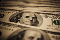Spotlight macro photo of $100 bills. Stock Image