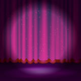 Spotlight on magenta stage curtain Stock Images