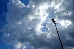 Spotlight Pole with Blue Sky and Clouds Background. Royalty Free Stock Photos