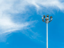 Spotlight pole round by cloud and sky Stock Image