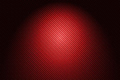 Spotlight on red carbon fiber Stock Images