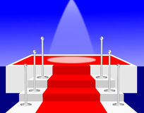 Spotlight on a Red Carpet Stage Royalty Free Stock Photo