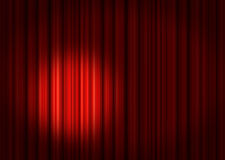 Spotlight on red Stage Curtains. Red velvet theater stage curtains with spotlight Royalty Free Stock Photos