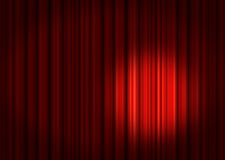 Spotlight on red Stage Curtains. Red velvet theater stage curtains with spotlight Royalty Free Stock Image