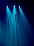 Spotlight from scanner. Three rays of bluish light emanate from a scanner Royalty Free Stock Image