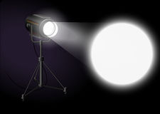Spotlight shines bright spot on the wall Royalty Free Stock Images