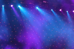 Spotlight show. Style color light show on dark background on the music stage Stock Photos