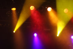 Spotlight show. Style color light show on dark background on the music stage Royalty Free Stock Image
