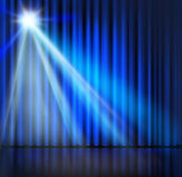 Spotlight on stage curtain blue background. Stock Photography