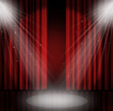 Spotlight on stage curtain red background. Royalty Free Stock Image