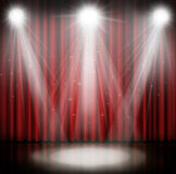 Spotlight on stage curtain red background. Royalty Free Stock Photo