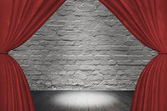 Spotlight on stage with red curtain Royalty Free Stock Photography