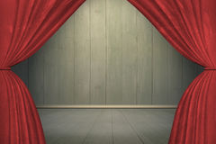 Spotlight on stage with red curtains Stock Images