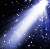 Spotlight with stars. On blue background Royalty Free Stock Photos