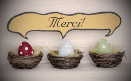 Spotlight To Three Colorful Easter Eggs With Comic Speech Balloon Merci Means Thank You Royalty Free Stock Photography