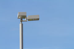 Spotlight on top of pole against blue sky Royalty Free Stock Image