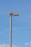 Spotlight on top of pole against blue sky Royalty Free Stock Photography
