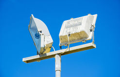Spotlight tower against blue sky. Stock Photography