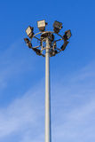 Spotlight tower on blue sky. Background Stock Photos